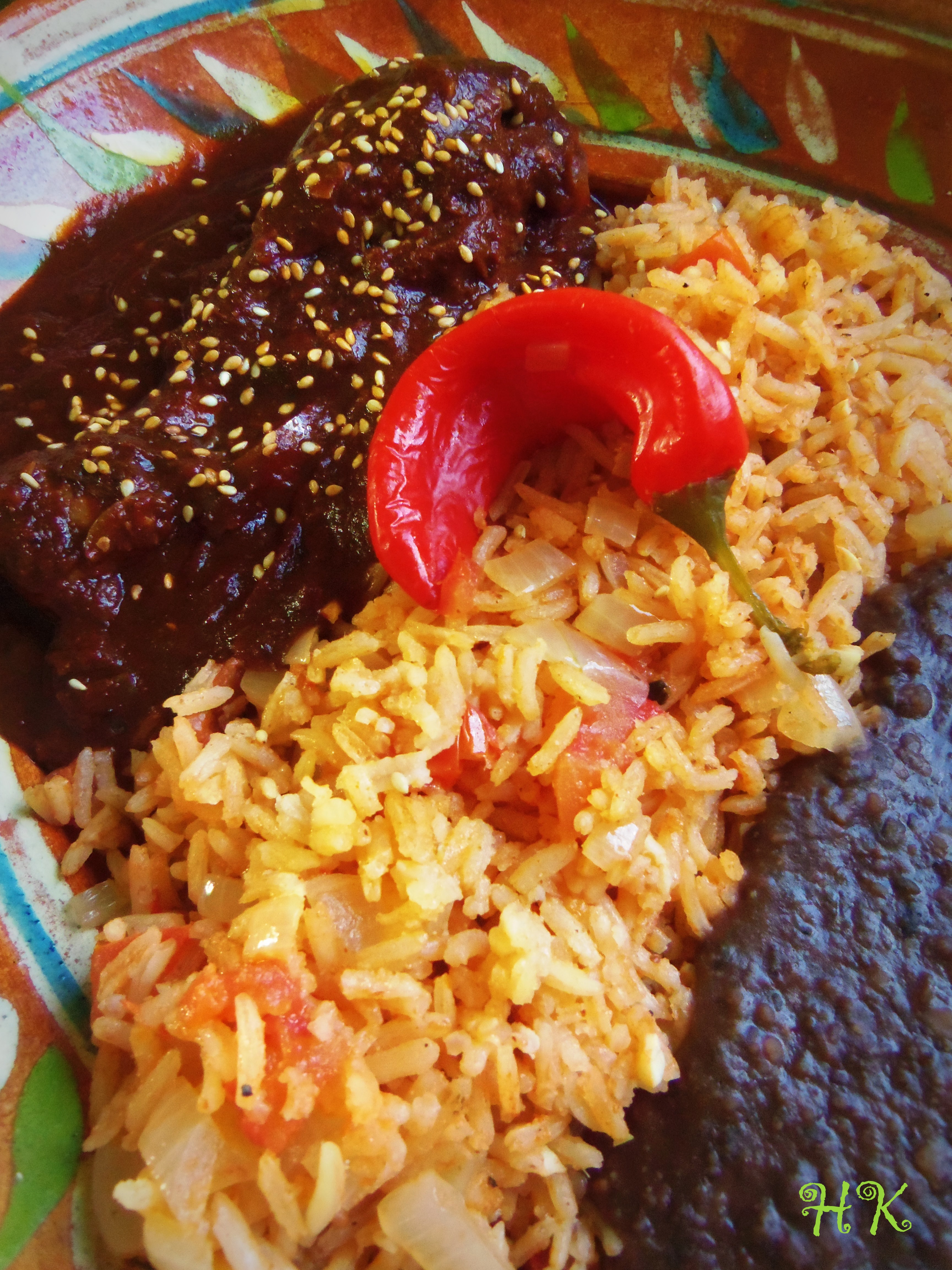 Chicken Mole, Mexican Red Rice and Refried Black Beans.