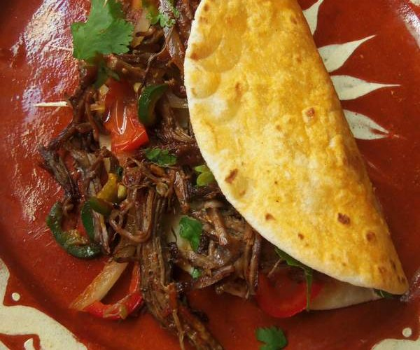 You could serve as-is or you could add some onions, chile peppers and tomatoes. Garnish with cilantro and serve with warm tortillas and salsa.