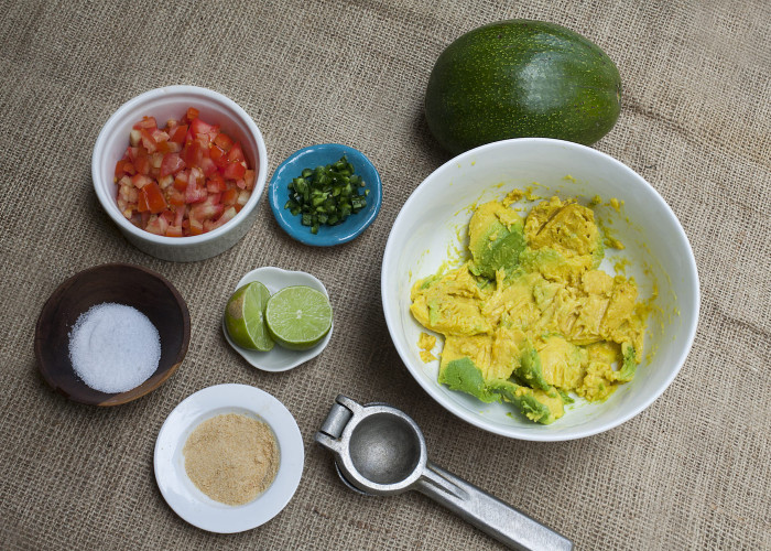Cut the avocados in half, and twist to remove the pit. Scoop out the pulp. Place in a medium-size bowl and mash the avocado with a fork so that the mixture is a bit chunky.