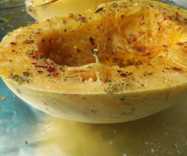 Slice the squash open and remove the seeds. Drizzle open sides with olive oil. Season with salt, pepper, garlic powder, crushed red pepper flakes and pinch of oregano. Place cut side down onto lined baking pan/dish. Bake for 45 to 50 minutes.