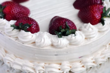 Tres Leches Cake With Arequipe Whipped Cream and Strawberries
