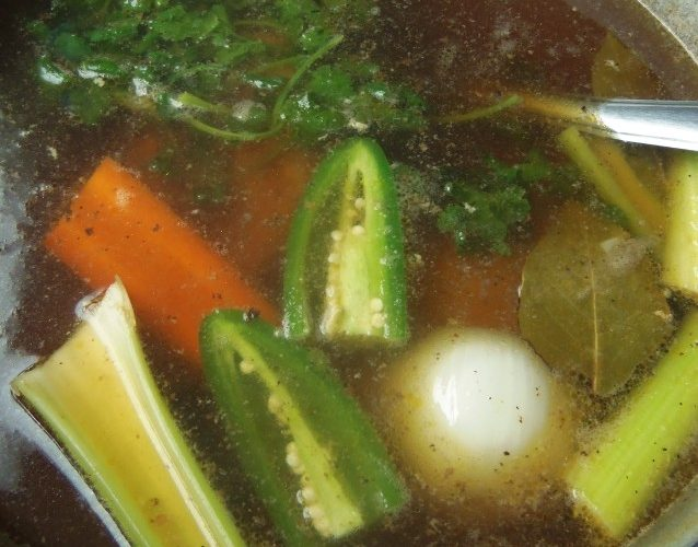 To the pot of chicken, add all of the ingredients listed, minus the corn, dry noodles and cilantro. Bring to a boil, reduce to a simmer and cover again. Cook for another 35 to 40 minutes. Raise heat slightly so soup is simmering vigorously, add the corn and noodles. Cook for just 7 to 9 minutes just until noodles are cooked. Remove from heat and add in the cilantro. Gently stir, cover and let sit for 10 minutes. Garnish with lime, jalapeño and fresh cilantro. Serve with warm corn tortillas.