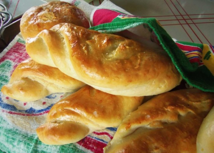 Note: A couple different shapes you can make for this bolillo style recipe are round or a longer bread, birote-style. These were brushed with egg wash, which gives them that shiny finish.