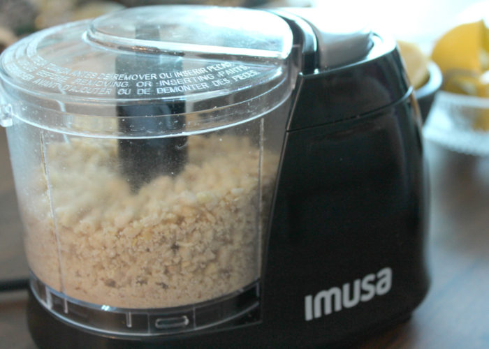 Place the cashews in a food processor and pulse until the cashews have been reduced to smaller pieces, but not quite powdered.