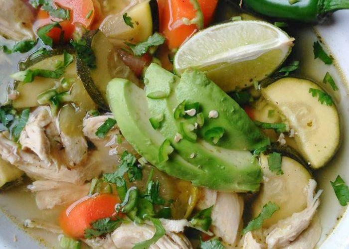 Garnish soup with fresh cilantro, avocado and serrano. Serve with warm corn tortillas.