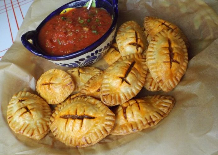 Use a fork and press around edges. Score a 1-inch section down the center of empanada, then three small lines across. Brush tops with eggwash. Bake for 25-30 minutes or until golden brown. The taco meat is enough to prepare a double batch of empanadas. Serve with your favorite salsa.