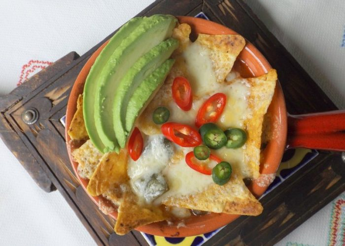 When you are ready to serve, ladle soup into individual stoneware crocks or heavy bowls that are ovenproof. Add some tortilla chips and a generous portion of shredded cheese on top. Place under the broiler just until cheese melts. Garnish with fresh sliced chile pepper, sliced avocado and cilantro.