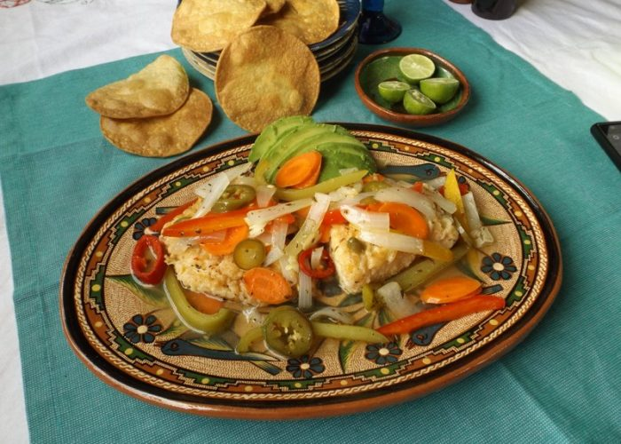 Pour escabeche over fish in baking pan. Cover and let sit at room temperature for 40 to 60 minutes. Serve at room temperature. Serve fish pieces in a shallow dish with escabeche. Ladle some of the liquid over top. Serve with avocado, tostadas and lime wedges