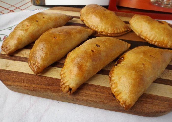 Place empanadas on lined baking sheets. In a small bowl, whisk the remaining egg with 1 tablespoon of water. Brush empanadas with eggwash. Preheat oven to 375ºF. Bake for 30 minutes on the bottom rack of oven. Move to the middle and finish browning under the broiler for 1 to 2 minutes. Serve warm or at room temperature.