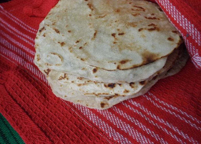 Transfer cooked tortillas to a tortilla warmer or a covered pot lined with a kitchen towel. The steam created will yield an extra soft tortilla. Cool tortillas completely before storing in a plastic storage bag.