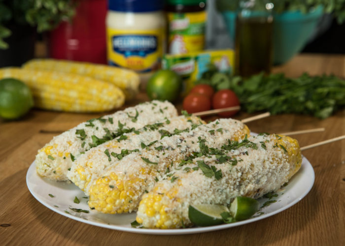 Serve warm on a plate and drizzle wth the remaining mayonnaise mixture, rotating the corn to cover evenly. Sprinkle with cheese.