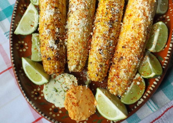 Remove from grill and immediately add a generous tablespoon of salsa butter (either flavor) to your corn. Sprinkle with cotija cheese and chile limon seasoning. Serve with lime wedges.