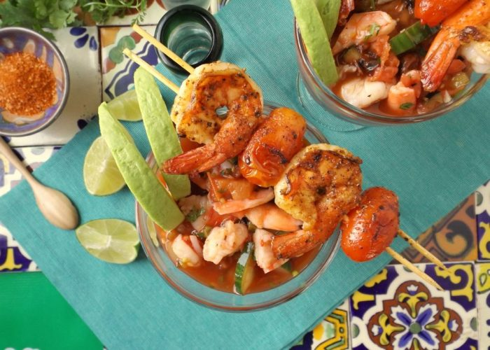 Remove from pan and tent loosely with foil paper. Divide the shrimp cocktail into 4 large glasses. Garnish with avocado slices, shrimp skewers, more lime and hot sauce. Yields 4 larger lunch size servings or 6 smaller appetizer servings.