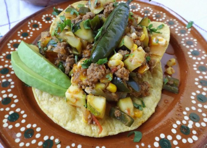 Stir in the corn, zucchini and oregano. Reduce heat slightly and continue cooking for 10-15 minutes, stirring as needed. Remove from heat and let sit for 10 minutes before serving. Serve on tostadas or serve with warm tortillas! A side of rice and beans are perfect!