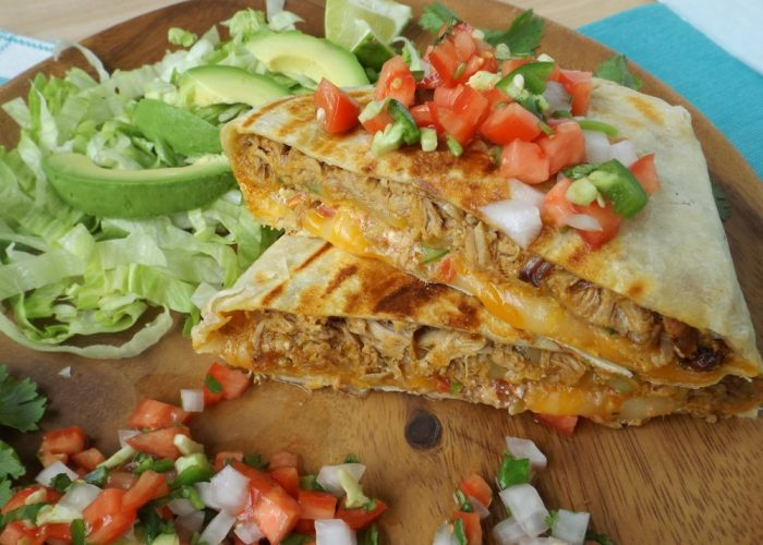 Place quesadillas onto cutting board and let rest for a few minutes before slicing into wedges. Serve with extra fresh salsa, sour cream, avocado and lettuce.