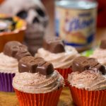 Spicy Mexican Chocolate Cupcakes with Peanut Butter frosting topped with Nestlé Butterfinger Peanut Butter Cups Skull