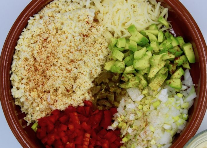 Place the eggs, onion, jalapeños, avocado and cheese in a bowl and mix gently.