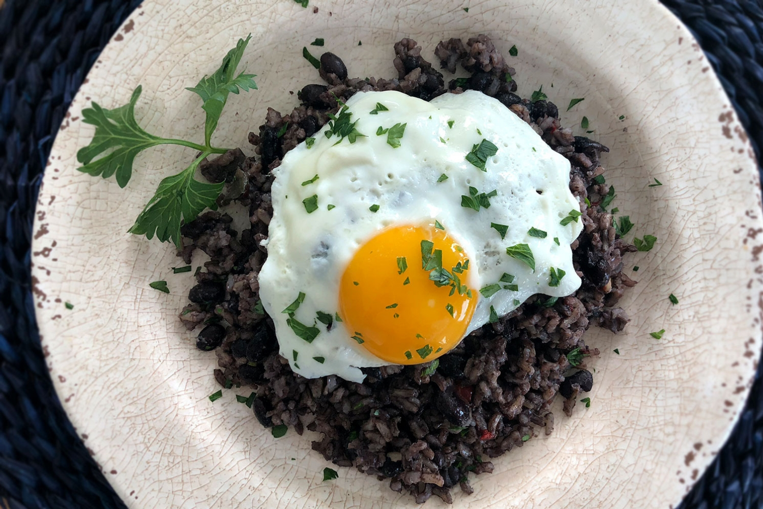 Gallo pinto with fried eggs (Costa Rican beans and rice)